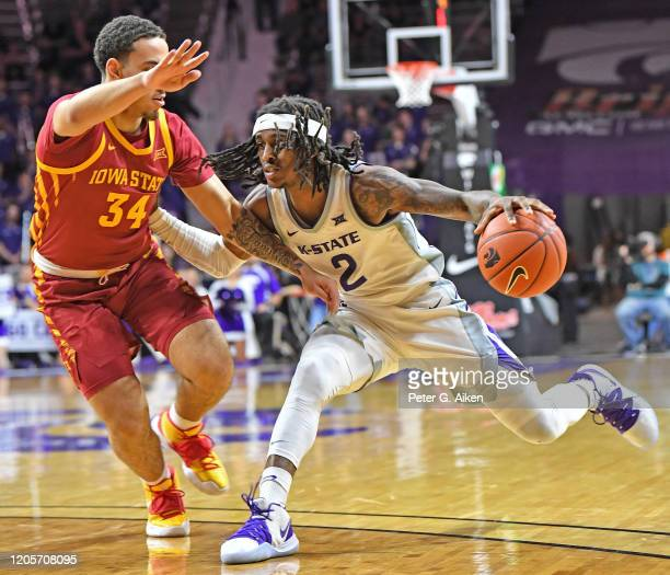 Cartier Diarra of the Kansas State Wildcats drives against Nate Jenkins of the Iowa State Cyclones during the second half at Bramlage Coliseum on...