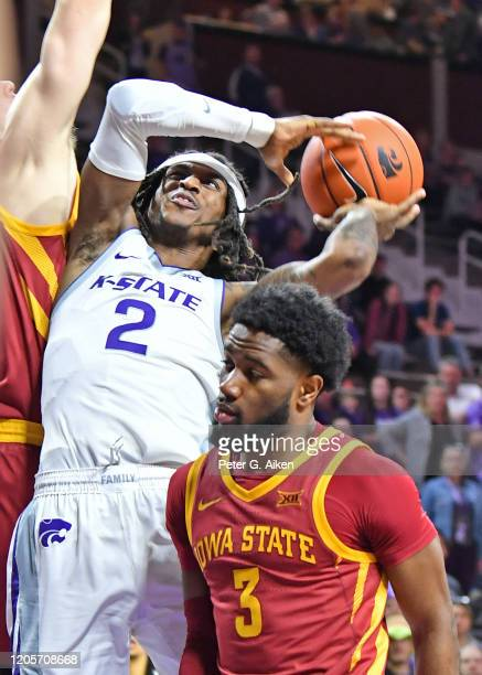 Cartier Diarra of the Kansas State Wildcats drives to the basket during the second half against Tre Jackson of the Iowa State Cyclones at Bramlage...