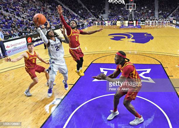 Cartier Diarra of the Kansas State Wildcats drives to the basket against Tre Jackson of the Iowa State Cyclones during the first half at Bramlage...