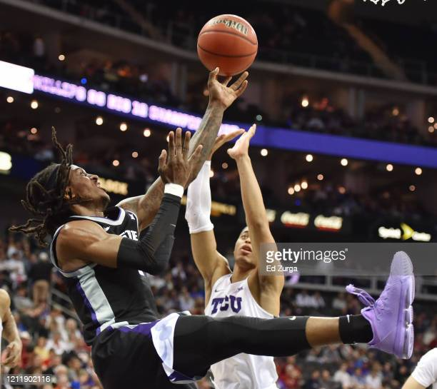 Cartier Diarra of the Kansas State Wildcats lays the ball up against Jaedon LeDee of the TCU Horned Frogs in the first half during the first round of...