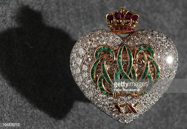Cartier emerald ruby and diamond broach from 1957 estimated at £100000 £150000 is displayed at Sotheby's on September 23 2010 in London England The...
