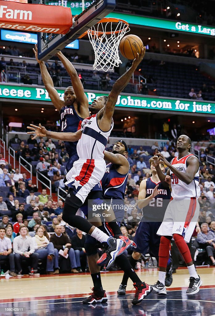 Cartier Martin #20 of the Washington Wizards puts up a shot in front of Al Horford #15 of the Atlanta Hawks at Verizon Center on December 18, 2012 in Washington, DC.