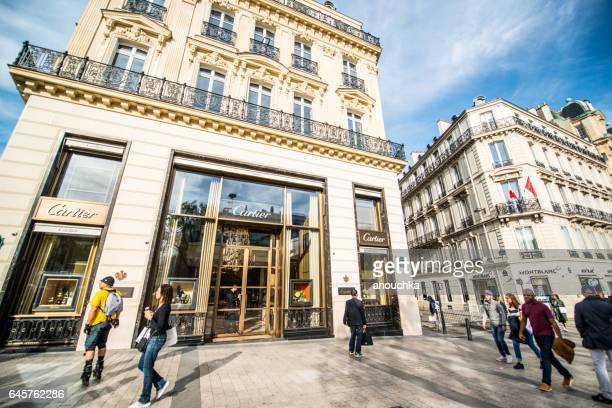 cartier store on avenue des champs-elysees and crowds of tourists, paris - avenue des champs elysees stock photos and pictures