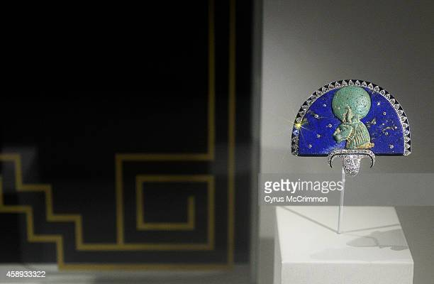 Cartier's 'Sekhmet Brooch' from 1925 is made with gold platinum blue Egyptian faience diamonds rubies emeralds onyx and enamel and is on view as part...