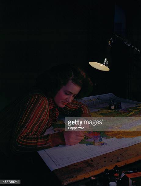 1944 A cartographer at work in the map section of the Ministry of Town and Country Planning December 1944