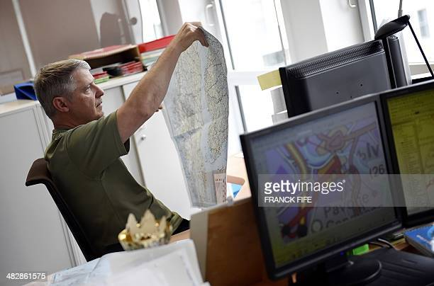 A cartographer works on April 3 2014 in BoulogneBillancourt near Paris Michelin which has published a map as part of the commemoration of the...