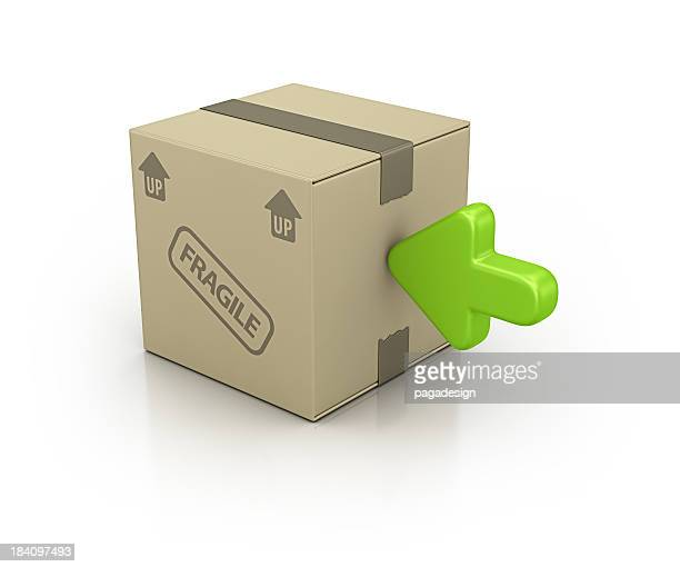 carton box and green arrow