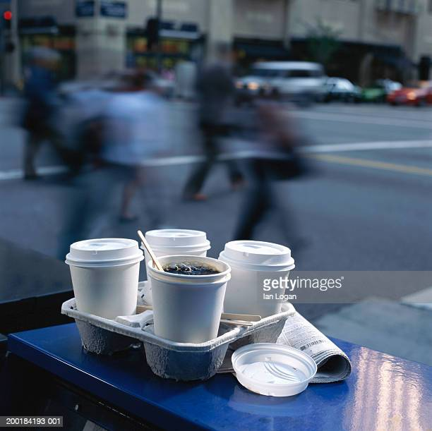 Carton tray with coffee cups on sidewalk table