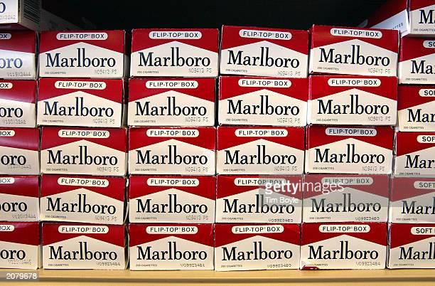 Cartons of Marlboro brand cigarettes are seen inside a Cigarettes Cheaper store June 13 2003 in Niles Illinois The US Surgeon General told Congress...