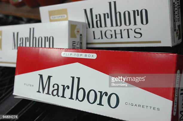 Cartons of Marlboro cigarettes are arranged on a delicatessen counter Friday February 11 in New York Altria the New Yorkbased maker of Marlboro...
