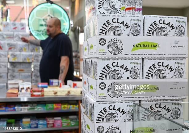 Cartons of White Claw, a flavored alcoholic fizz in a can are on display at the Round The Clock Deli September 11, 2019 in New York City. -...