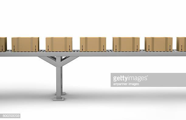 Cartons on a conveyor belt on white