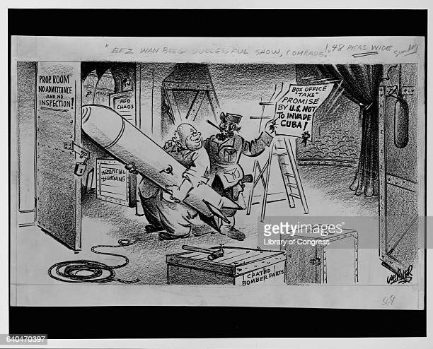 A cartoon about the Cuban Missile Crisis depicting Fidel Castro holding a certificate reading box office promise by US not to invade Cuba as Nikita...