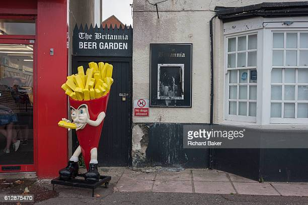A cartoon character promotes chips outside the now vacant Britannia pub on 17th September 2016 on the Eastern Esplanade at Southend Essex England...