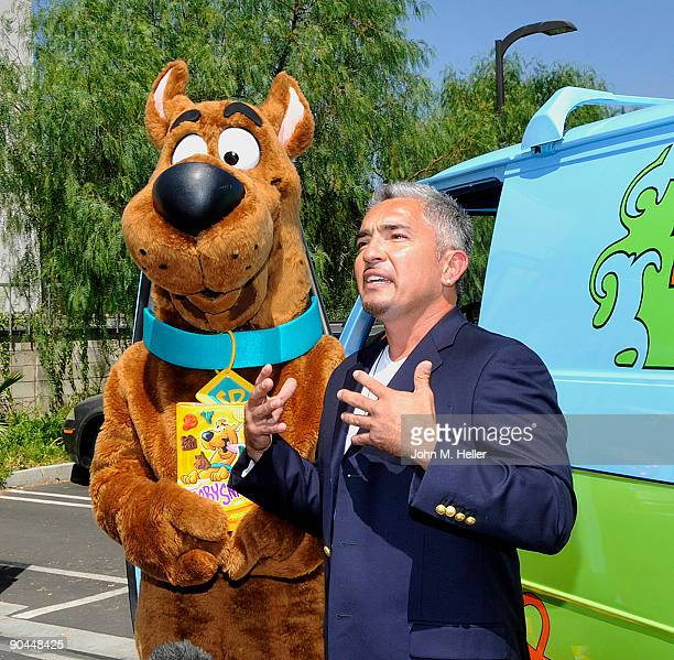 Cartoon character ScoobyDoo and host of the Dog Whisperer Cesar Millan attend their 40th birthday celebration at the East Valley Animal Shelter on...
