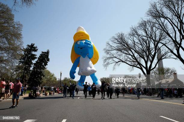 Cartoon characters balloons float as people take part in the '2018 National Cherry Blossom Festival Parade' in Washington United States on April 14...