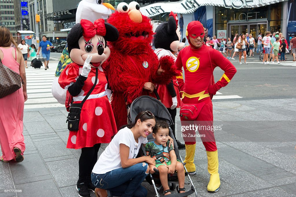 cartoon characters in times square stock photo getty images