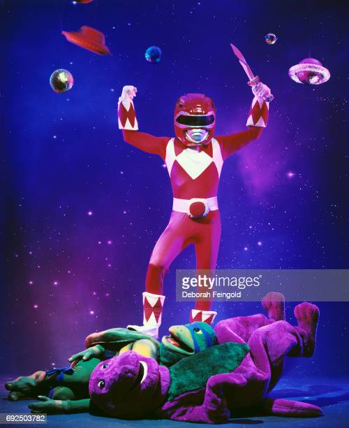Cartoon characters Power ranger and Barney pose for a portrait in 1994 in New York City New York
