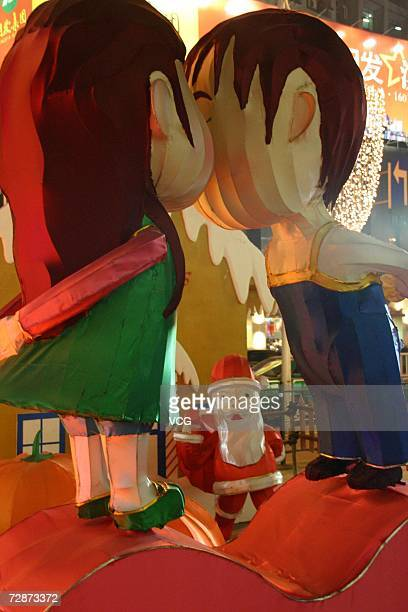 Cartoon decoration for upcoming Christmas debuts outside a shopping mall on December 22 2006 in Nanjing Jiangsu Province China While Christmas Day is...
