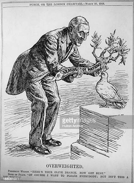 A cartoon entitled 'Overweighted' depicting US President Woodrow Wilson handing a heavy olive branch representing the League of Nations to a dove of...