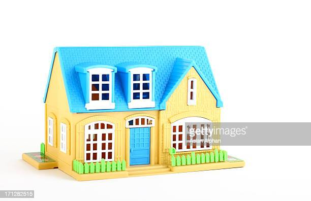 A cartoon image of a blue and yellow house