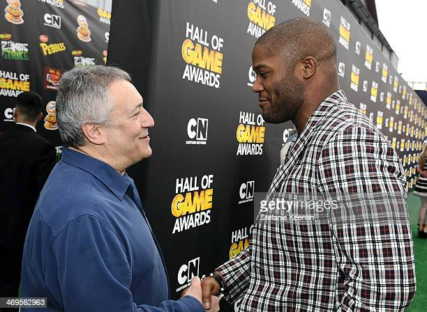 Cartoon Network President/COO Stuart Snyder and fullback Michael Robinson of the Seattle Seahawks attend Cartoon Network's fourth annual Hall of Game...