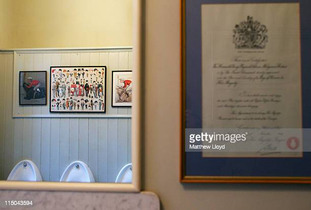 Cartoon sketches in a lavatory in Highclere Castle on March 15 2011 in Newbury England Highclere Castle has been the ancestral home of the Carnarvon...