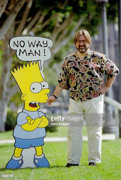 Cartoonist and creator of The Simpsons stands 1992 with a cardboard cutout of Bart Simpson
