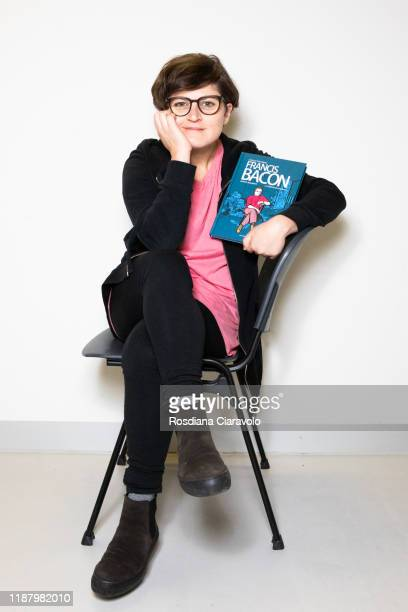 Cartoonist Cristina Portolano poses with her new graphic novel Francis Bacon La violenza di una rosa during the Bookcity Milan 2019 on November 15...