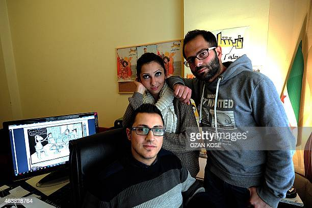 Cartoonist Hala Ismail Ziyad Il Siriana and Mohammad Bakfalouni work about cartoons about Islamic State members at their home office on January 25...