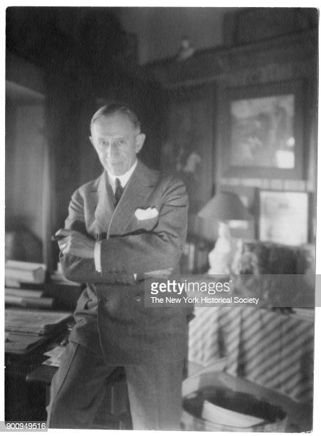 Cartoonist John McCutcheon in suit with handkerchief in breast pocket arms crossed in front of chest cigar in hand 1922