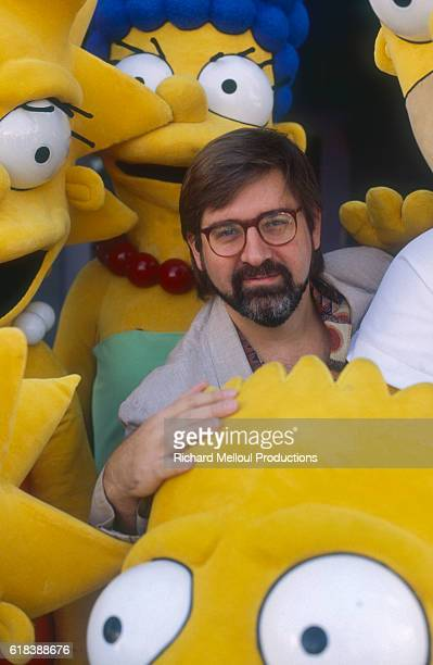 Cartoonist Matt Groening poses with chaaracters from his animated TV series 'The Simpsons' November 1990