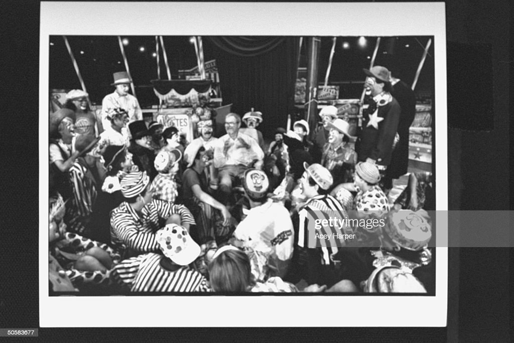 Cartoonist/ex-dir. of animation for Warner Bros. Chuck Jones (rear-C) surrounded by two dozen clowns, lecturing & answering questions at the Ringling Bros. & Barnum Bailey Clown College.