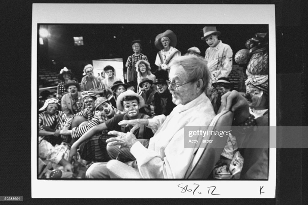 Cartoonist/ex-dir. of animation for Warner Bros. Chuck Jones (fore-R) surrounded by two dozen clowns, lecturing & answering questions at the Ringling Bros. & Barnum Bailey Clown College.