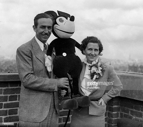 Cartoons and Animation 12th June 1935 Famous American animator Walt Disney and his wife Lillian with cartoon character Mickey Mouse on the roof of...