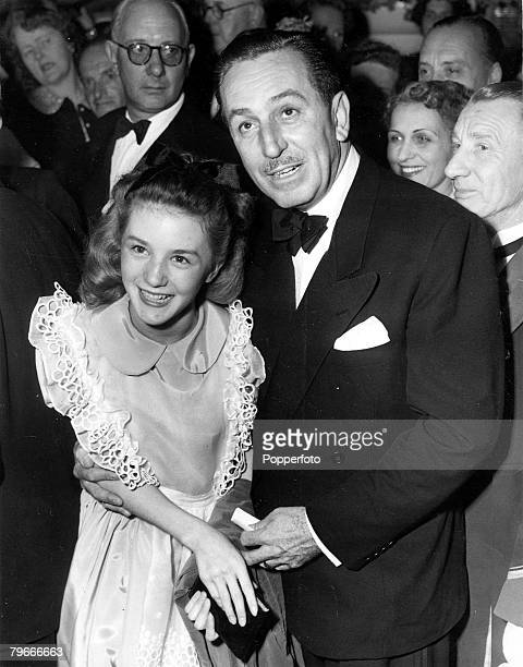 Cartoons and Animation, 26th July 1951, London, England, US artist and film producer Walt Disney is pictured here with child actress Kathryn...
