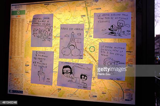 Cartoons are displayed on a city map following the recent terrorist attacks on January 11 2015 in Paris France An estimated one million people have...