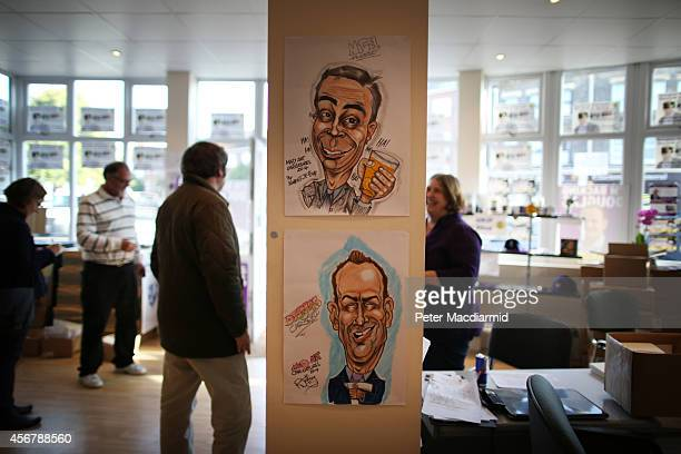 Cartoons of United Kingdom Independence Party leader Nigel Farage and byelection candidate Douglas Carswell adorn a wall in their campaign office on...