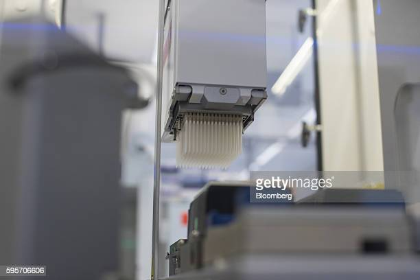 A cartridge of pipettes sit inside a cell screening machine at Galapagos NV's biotechnology laboratory in Leiden Netherlands on Wednesday Aug 24 2016...