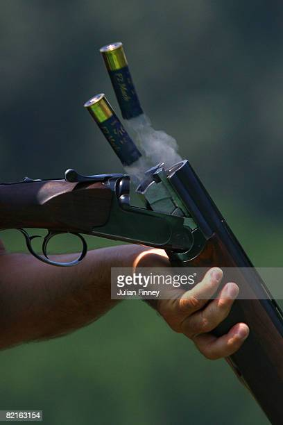 Cartridges pop out of a Shotgun as a competitor practices ahead of the Beijing 2008 Olympics at the Beijing Shooting Range CTF on August 3 2008 in...