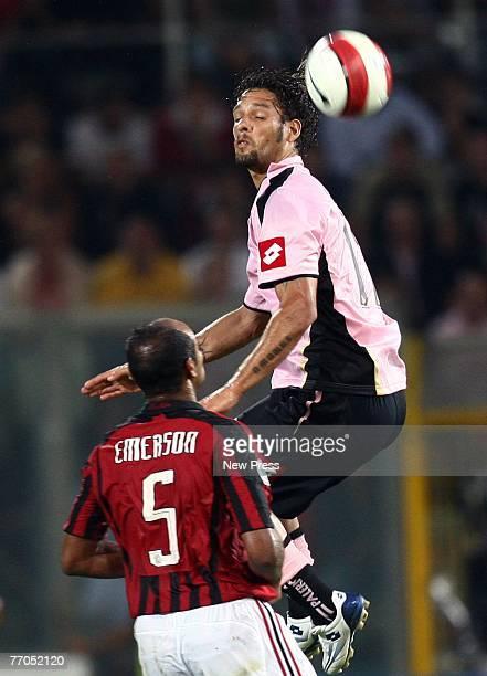 Carvalho de Oliveira Amauri of Palermo heads the ball over Fereira da Rosa Emerson of AC Milan during the Italian serie A football match between...
