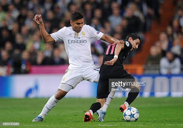 Carvallo of Real Madrid tackles Angel Di Maria of Paris SaintGermain during the UEFA Champions League Group A match between Real Madrid CF and Paris...