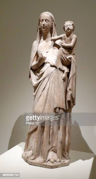 Carved alabaster statue of Mother of God by Anonymous. Dated 14th Century.