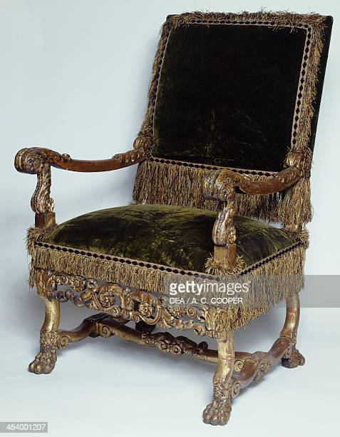 Carved and gilt wood armchair with upholstered back and seat England 17th century London Victoria And Albert Museum