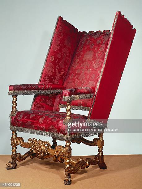 Carved and gilt wood sleeping chair with adjustable back 1679 England 17th century London Victoria And Albert Museum