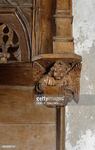 Carved angel detail from the wooden choir stalls from the chapel of the castle of the Marquis of Saluzzo in Revello Casa Cavassa Saluzzo Piedmont...