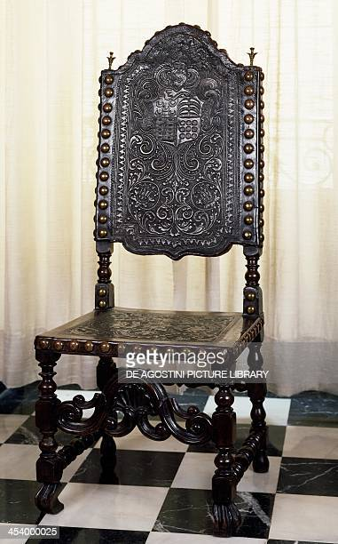 Carved chair upholstered in leather fastened by studs Spain 17th century Madrid Museo Nacional De Artes Decorativas