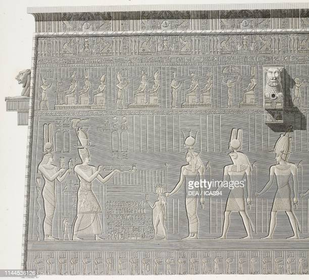 Carved decorations on the rear wall of Hathor Temple, Dendera Temple complex, Egypt, engraving after a drawing by Jollois and Devilliers, from...