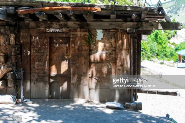 Carved entrance door of a traditional kalash house on Mai 18, 2016 in Bomburet, Khyber Pakhtunkhwa, Pakistan.