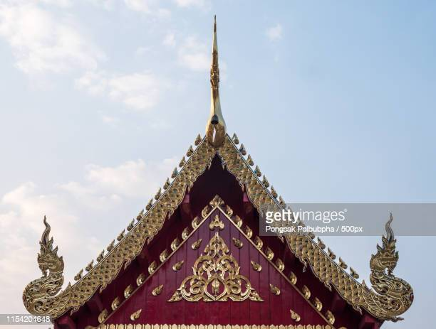 carved floral pattern on the gable - place of worship stock pictures, royalty-free photos & images